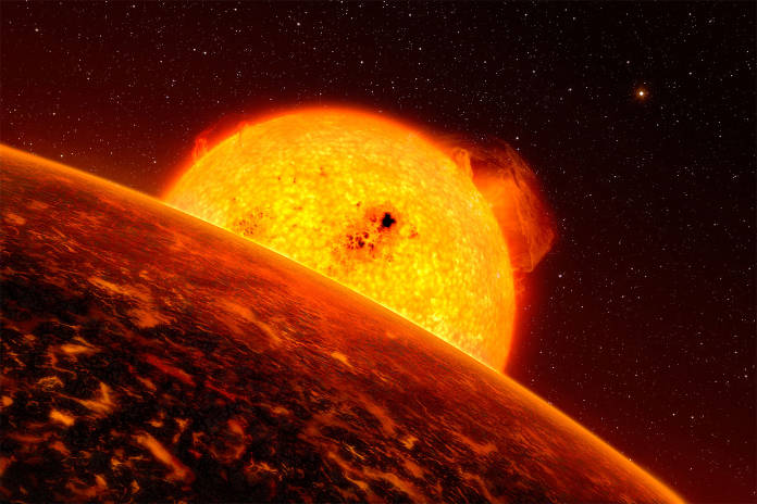 This artist's impression shows sunrise over CoRoT-7b, the smallest-known exoplanet.
